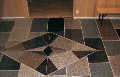 Erivärisillä graniiteilla voidaan luoda lattiaan kuvioita.